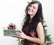 Free Christmas: Brunette Girl With Gift Royalty Free Stock Images - 22418439