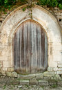 Free Old Closed Wooden Door With Concrete Arc Stock Image - 22432591