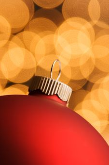 Red Ornament With Gold Defocused Lights Stock Image