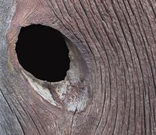 Free Knot Hole In A Board Royalty Free Stock Photography - 22443857