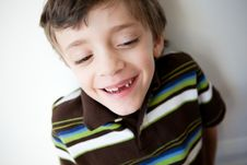 Free Laughing Boy Showing Missing Front Tooth Royalty Free Stock Photo - 22448255