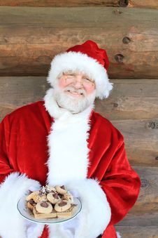 Free Santa Holding Cookie Plate Royalty Free Stock Image - 22448516