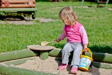 Free The Girl Playing To A Sandbox Stock Photos - 22449253