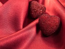 Free Hearts On Satin Background Stock Images - 22455454