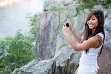 Free Woman Photographing Scenic River Stock Photos - 22455523