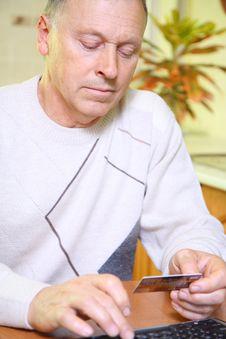 Free Senior Man Using Credit Card To Shop Stock Image - 22458581