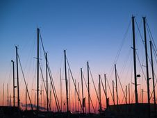 Masts Of Sail Boats In Sunset Stock Photos