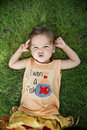 Free Baby Lying On The Grass Royalty Free Stock Photography - 22464747