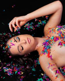 Free Pretty Model Playing With Bright Confetti Stock Image - 22460201