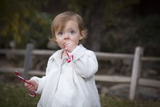 Adorable Baby Girl Playing In Park Stock Photography
