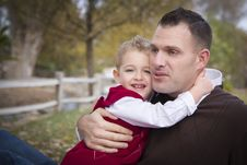 Handsome Father And Son In The Park Stock Images