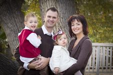 Free Attractive Parents And Children Portrait In Park Stock Photography - 22461612