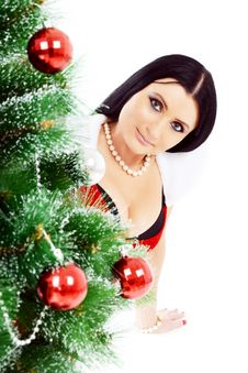 Free Beautiful Woman Near A Christmas Tree Stock Photography - 22461762