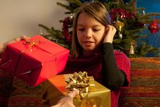 Free Father Offering Christmas Gifts Royalty Free Stock Images - 22465119