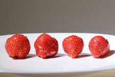 Four Red Strawberry Stock Photography