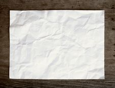 Free Crumpled Paper On Wooden Background Royalty Free Stock Images - 22468379