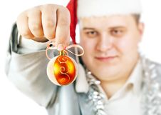 Young Man Holding A Christmas Toy. Royalty Free Stock Images