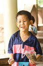 Free Asian Boy Holding Fish Food To Feeding Stock Images - 22478954