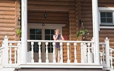 Free The Woman On The Balcony Royalty Free Stock Photography - 22476837