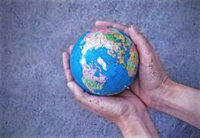 Free Earth In Hands Stock Photo - 22479210