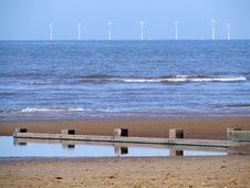 Beach And Turbines Royalty Free Stock Photography