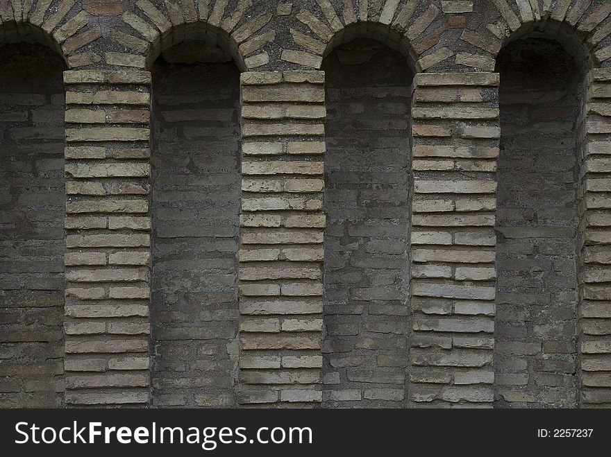 Four archs in old wall