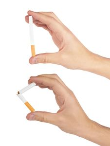 Free Hand Breaking And Holding A Cigarette Stock Photo - 22506790