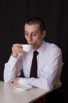 Free Surprised Businessman Drinking Coffee Royalty Free Stock Image - 22508596