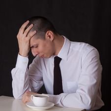 Free Upset Businessman Drinking Coffee Royalty Free Stock Photos - 22508598