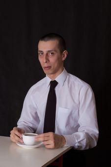 Free Suspiciuos Businessman Drinking Coffee Stock Photos - 22508603