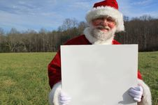 Free Santa With A Blank Sign 2 Stock Photo - 22512720