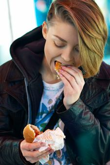 Free Portrait Of Girl With Eats Burger On The Terrace Stock Photography - 22523632