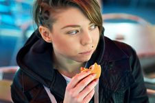 Free Portrait Of Girl With Eats Burger On The Terrace Royalty Free Stock Photography - 22523867