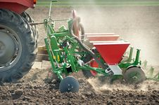 Free Tractor And Seeder Royalty Free Stock Photos - 22524638