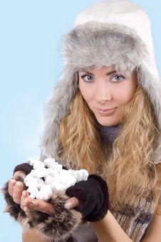 Woman In Winter Hat And Gloves With Snow Royalty Free Stock Photography