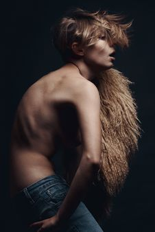 Dark Picture Of Sexy Woman In Lama Fur And Jeans Stock Image