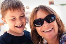 Free Mom Holding Happy Son And He Laughs Royalty Free Stock Image - 22535166