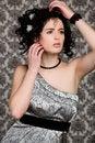Free Brunette Model In Silver Dress Stock Photography - 22549592