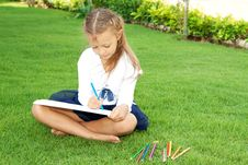 Girl Drawing Stock Photography
