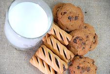 Free Milk And Cookies Of Different Flavors Stock Image - 22542231