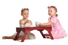 Free Pretty Twins Sisters Have Tea Isolated Stock Photos - 22543563
