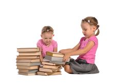 Free Pretty Twins Girls With Pile Of Books Isolated Stock Images - 22543684