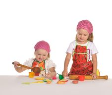 Free Two Little Housewifes In Colourful Aprons Stock Photography - 22543742