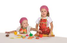 Free Two Little Housewifes In Colourful Aprons Stock Images - 22543744
