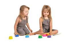 Free Twins Sisters In Rompers With Paints Isolated Royalty Free Stock Photography - 22543787