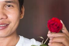 Potrait Of Man And Rose Stock Photo