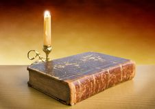 Candlestick And Old Book Royalty Free Stock Image