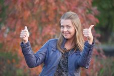 Free Pretty Positive Girl With Thumbs Up Stock Photography - 22554782