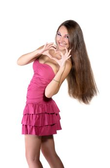 Girl In Pink Dress, Shows The Heart Royalty Free Stock Photo