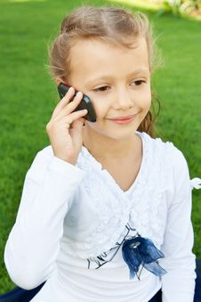 Free Girl Talking On Mobile Phone Royalty Free Stock Photo - 22568475